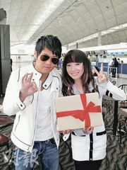 Chita with Gary Cao at the airport where Gary surprised her with a present.