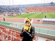 Janis at a football game in Japan