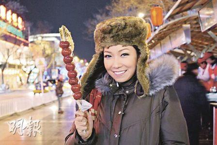 Chita enjoying some traditional Chinese snacks at Wangfujing.