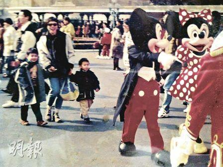 Six-year-old Jonathan (left) visited Tokyo Disneyland with his mother and his little brother.