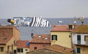 The Costa Concordia Cruise ship is pictured listing off the coast of an island in Italy, 16 January 2012. EPA Photo.