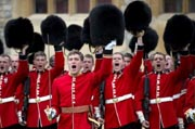 British soldiers from the Coldstream Guards remove their headgear in order to honour Britain's Queen Elizabeth II during a ceremony where she presented New Colours to the 1st Battalion and No. 7 Company the Coldstream Guards at Windsor Castle, Berkshire, west of London, on May 3, 2012. AFP Photo