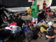 This photo dated December 6, 2011 shows Afghan Shia Muslim 12-year-old girl crying near dead and injured people after explosions during a religious ceremony at the Abul Fazel shrine in the centre of Kabul where Shia Muslims were marking the Day of Ashura. AFP Photo