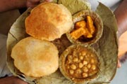 Indian food: pooris (fried puffed wholewheat flat bread), channa or chole masala (chickpeas).   (AFP Photo)