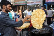 A Kashmiri Muslim vendor prepared a flatbread popularly known as paratha in Srinagar.  (AFP Photo)