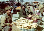 Afghan men sold roti at an open market in downtown Kabul.  (AFP Photo)