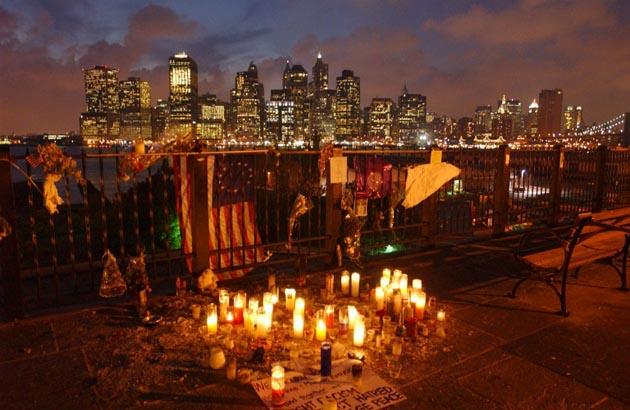 Candles were lit at a memorial for victims of the World Trade Center attack September 2001 in Brooklyn across the East River from Manhattan in New York. AFP Photo