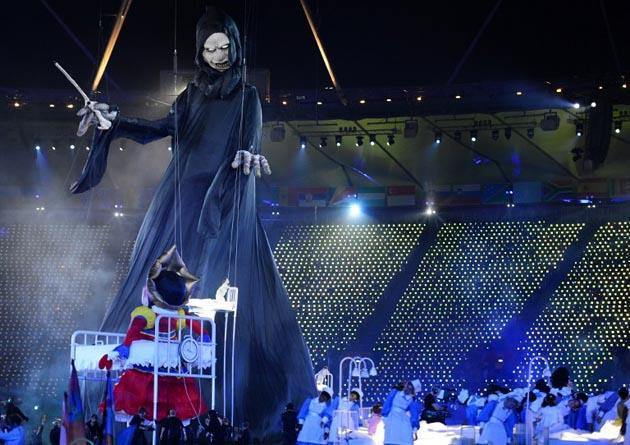 Giants puppets depicting villains from British literature including Lord Voldemort from the Harry Potter books and the Child Catcher from Chitty Chitty Bang Bang swirled around the stage during the opening ceremony of the London 2012 Olympic Games. AFP Photo