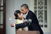 US President Barack Obama kissed Myanmar opposition leader Aung San Suu Kyi after speaking to the press following their meeting at her residence in Yangon on November 19, 2012. AFP Photo