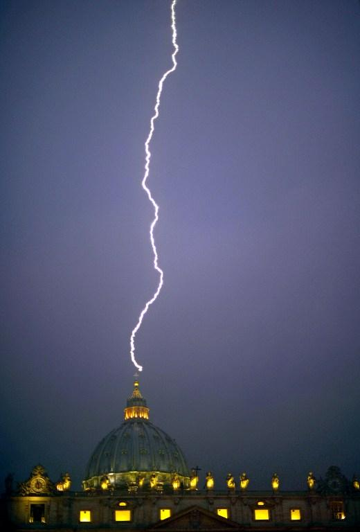 A lightning stroked St Peter's dome at the Vatican on February 11, 2013. AFP Photo