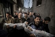 This handout photo taken by Swedish photographer Paul Hansen and released by the World Press Photo shows the bodies of two year-old girl and her three-year-old brother, who were killed when their house was destroyed by an Israeli missile strike, being carried on November 20, 2012 in Gaza City. AFP Photo/ Dagens Nyheter/ PAUL HANSEN.