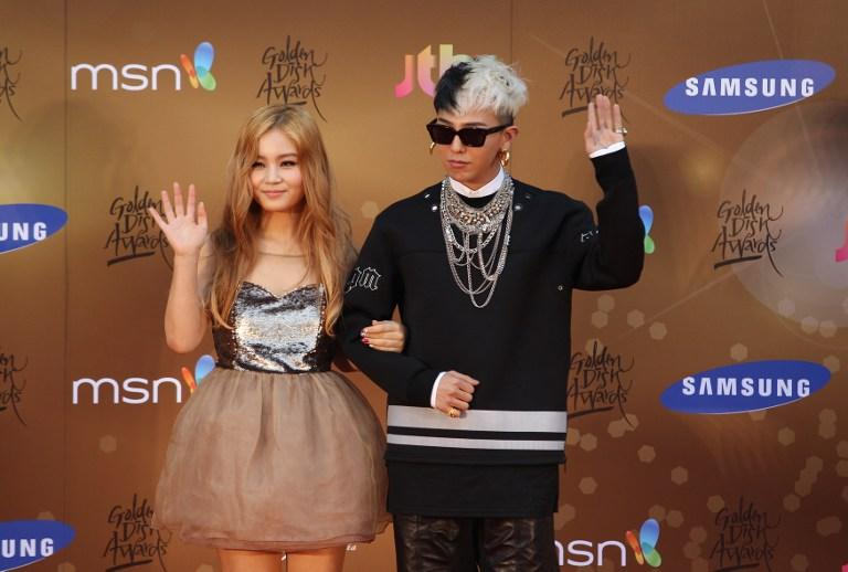 South Korean K-pop singer G-Dragon (right) and Lee Hi (left) posed on the red carpet during the final day of the Samsung Galaxy the 27th Golden Disk Awards at the Sepang International Circuit in Sepang outside Kuala Lumpur on January 16, 2013. AFP Photo