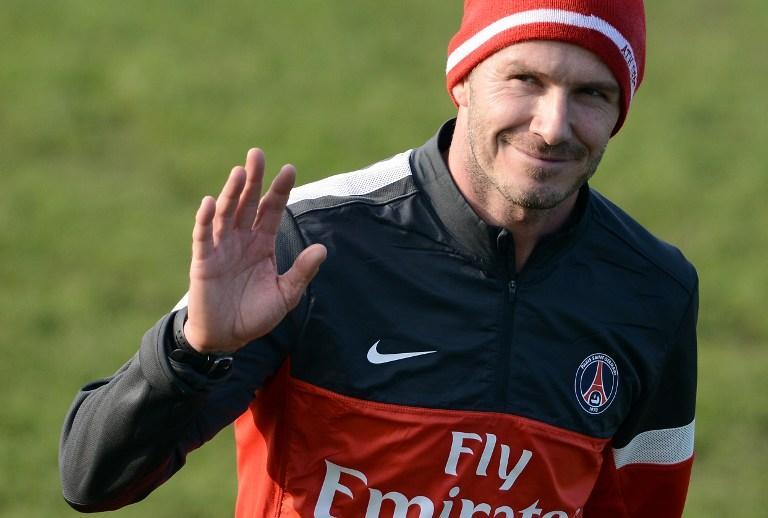 Paris Saint-Germain's British midfielder David Beckham waved as he left a training session on February 13, 2013 at the club's Camp des Loges training center in Saint-Germain-en-Laye, near Paris. AFP Photo