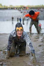 A participant reached the finish line of the annual Maldon Mud Race in Maldon, Essex, Britain on May 5, 2013. AFP Photo