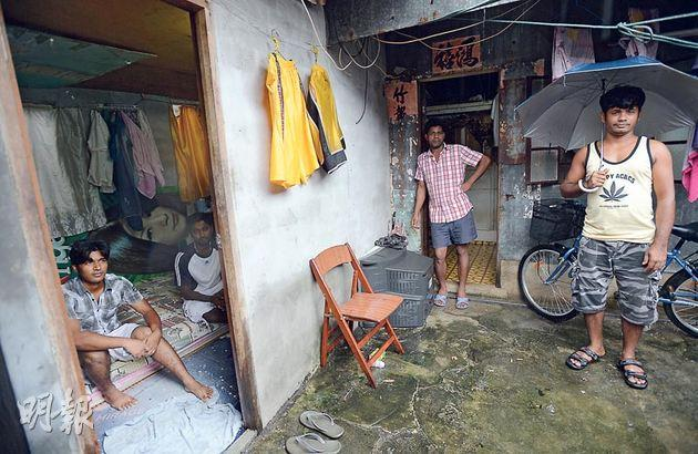 Bangladeshi asylum seekers living in subdivided flats in Fanling. Many asylum seekers, without a work permit, can't find a job and have to face poor living conditions.