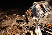 A photo taken on Dec 4, 2013 shows a house damaged in a landslide in Longnan City, northwest China's Gansu Province.  (Xinhua Photo)