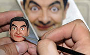 A dough modelling craftsman, Zhang, worked on a dough figurine of Mr. Bean at his studio in Changchun, capital of northeast China's Jilin Province, on Dec 1, 2013. (Xinhua Photo)