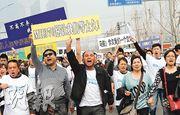 馬航遇難者家屬早前往馬國駐京大使館示威。