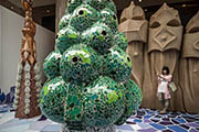 A girl took a picture at an exhibition showcasing works of Antoni Gaudi in Hong Kong. (AFP Photo)