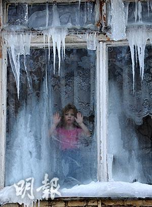 The window was covered with frost and ice. (AFP Photo)
