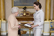 US actress Angelina Jolie (right) was presented with the Insignia of an Honorary Dame Grand Cross of the Most Distinguished Order of St Michael and St George by Britain's Queen Elizabeth II. (AFP Photo)