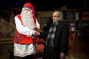 Indian President Pranab Mukherjee (Right) shook hands with a man dressing up as Santa as he visited the Santa Claus Village at the Arctic Circle near Rovaniemi, Finland. (AFP Photo)
