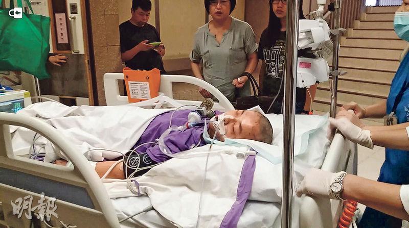 女傷者送往伊利沙伯醫院搶救,被剃去頭髮治理,至昨深夜仍危殆。據悉她頭部重創,腦部有瘀血,可能需再做手術。(林智傑攝)