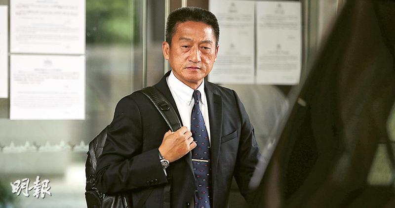 被告朱經緯昨日到西九龍裁判法院出席審前覆核,聆訊期間一直正襟危坐,沒有神情變化。(曾憲宗攝)