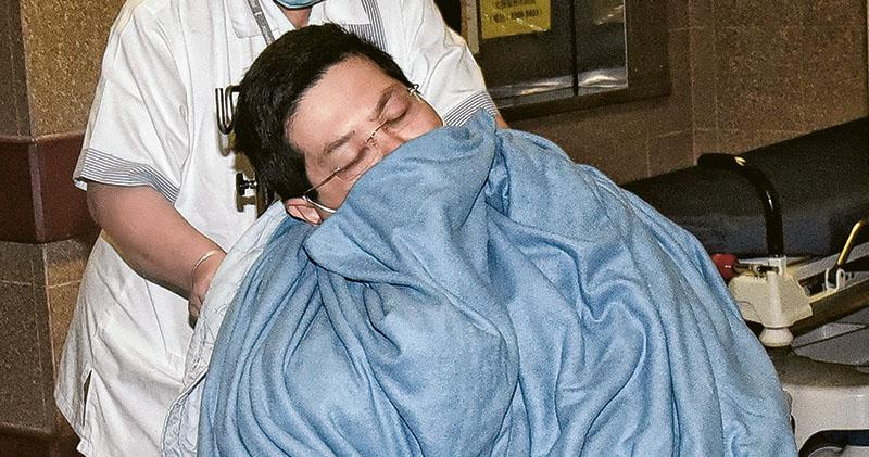 前晚扣查期間報稱身體不適被送到伊利沙伯醫院的林子健,昨晨由內科病房轉到羈留病房。(鍾炳然攝)