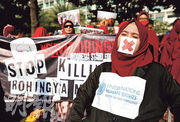 印尼雅加達有人權組織昨發起示威,聲援緬甸羅興亞族人。(路透社)