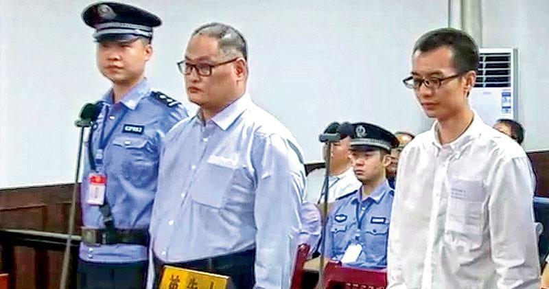 彭宇華(右)、李明哲(中)顛覆國家政權案一審,昨日在湖南省岳陽市中級法院一審公開審理。(中新社)