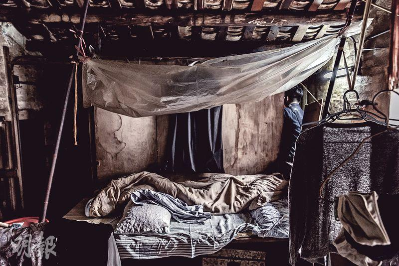 An old lady has lived in this shabby attic in a Tsuen Wan temple for decades.