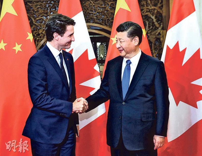 國家主席習近平(右)昨日在北京會見加拿大總理杜魯多。(新華社)