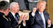 美國總統特朗普(右)周三在華盛頓國會山莊出席活動,在一名歌手表演期間拍掌和揮動手腳,狀甚投入。(路透社)