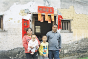 Mr. Li and his family have lived in a mud-brick house for 50 years. There are obvious cracks across the wall.