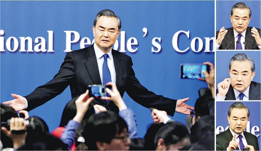 外長王毅昨日警告稱,選擇貿易戰是「抓錯藥方」,結果只會損人害己,「中方必有回應」。圖為王毅昨在記者會上回應記者提問。(路透社)