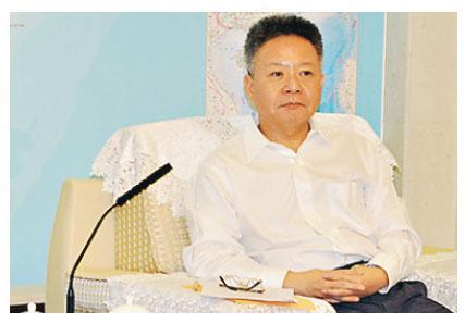 海南省長沈曉明(圖)表示,中央決定在海南建自貿區,為海南未來發展舉旗定向。(李泉攝)