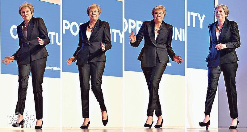 英國首相文翠珊昨在保守黨大會上展舞姿。(法新社)