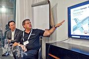 Axilion行政總裁Oran Dror(右)表示,他們開發的交通燈調控系統可讓公共交通工具,如輕軌列車、巴士等,在路口有優先過路權,減輕延時脫班;顧問之一Mark Joseph(左)是香港電車母公司Transdev環球首席發展總監,他相信香港電車使用該系統,可進一步提高營運效率。(林穎茵攝)