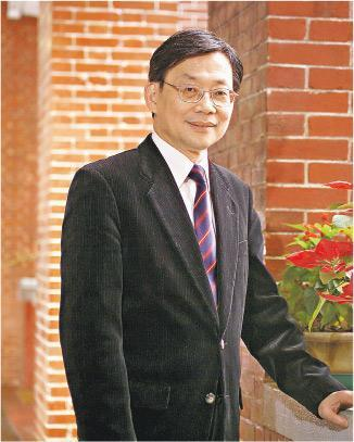 Principal Poon before retirement in 2004.