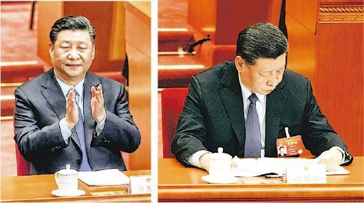 國家主席習近平昨在人大全體會議上認真閱讀人大委員長栗戰書宣讀的工作報告,並多次鼓掌。(法新社/鄭海龍攝)