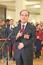 廣東省常務副省長林少春3月5日在「代表通道」上表示,廣東將重點在規則方面推動粵港澳三地聯通、貫通、融通。(新華社)