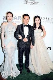 甄子丹(中)與太太汪詩詩(左)及女兒(右)日前出席慈善晚宴遭不禮貌對待,未開席便拉隊離場。(資料圖片)