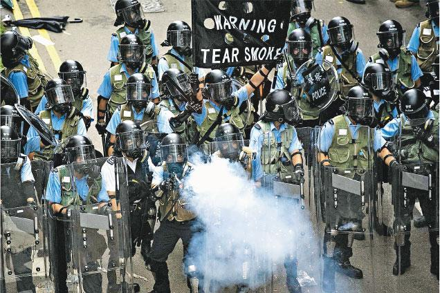 Police firing tear gas.(Photo: AFP)