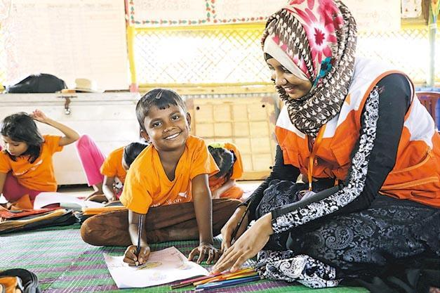 Sanjida particularly enjoys the drawing sessions at the child‑friendly space that she attends. (Photo: Himaloy Joseph Mree / World Vision)