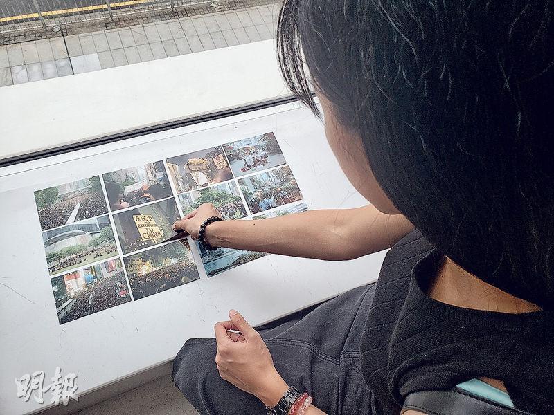翁小姐冲曬麥小姐生前用菲林相機拍下的照片,當中記錄了不少反修例的片刻。(羅嘉凝攝)