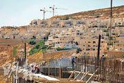 周三有巴勒斯坦工人在耶路撒冷北面的西岸地區一個殖民區工地上工作。(法新社)