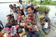 國際刑事法院昨日同意全面調查緬甸涉嫌逼害羅興亞人的指控。圖為2017年10月有渡河抵達孟加拉的羅興亞難民抱着兒子遺體痛哭。(法新社)