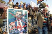 反政府示威者周四在巴格達集會,反對國會推舉巴士拉省省長艾達尼任總理。(法新社)