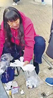 WhatsApp昨流傳一片段,一名女子在大圍一間診所門外收拾多個疑曾使用的口罩,有途人聲稱看到她由垃圾桶執出,懷疑其動機,二人展開罵戰。